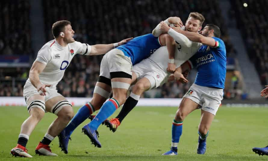 Elliot Daly on the receiving end of a heavy Sergio Parisse tackle at Twickenham
