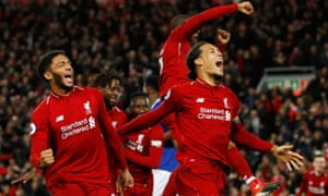 Liverpool celebrate after Divock Origi nodded in to give Liverpool the win late on.