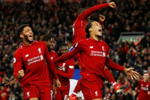. 2 December: Liverpool's Virgil van Dijk and Joe Gomes celebrate Divock Origi's goal against Everton.