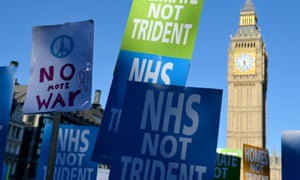 Demonstrators at an anti-Trident CND rally in Parliament Square, London, taking place as MPs debate Trident renewal.