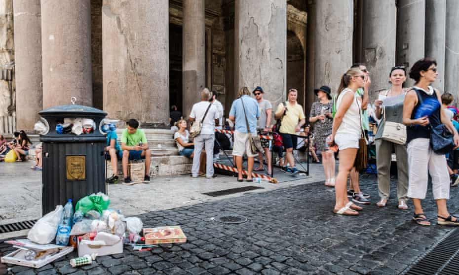 A bin overflows with waste in front of the Pantheon in central Rome.