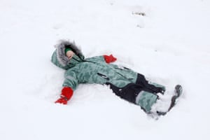 Francis makes a snow angel.