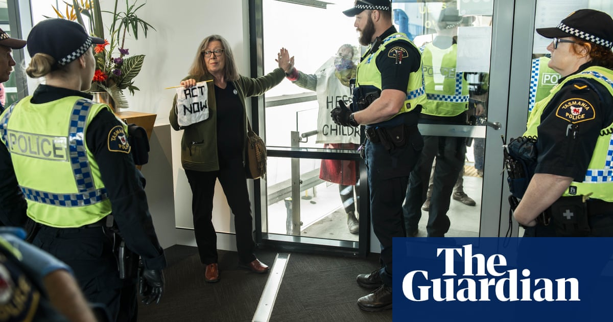 Sticky situation: Scott Morrison's speech disrupted as activist glues herself to window – The Guardian