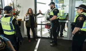 Extinction Rebellion protester Carol Rea after glueing her hand to a window inside the function centre where Tasmania's state Liberal council was being held