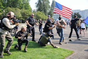 Salem, US Police officers try to break up a fight between supporters of president Trump, and Black Lives Matter protesters outside the Oregon State Capitol building