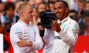 Lewis Hamilton talks with his Mercedes teammate Valtteri Bottas after the German Grand Prix