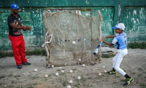 A boy practices in Havana on 16 March, 2016. A relaxing of US-Cuban relations could see the island nation become ' a nursery for the Major League'.