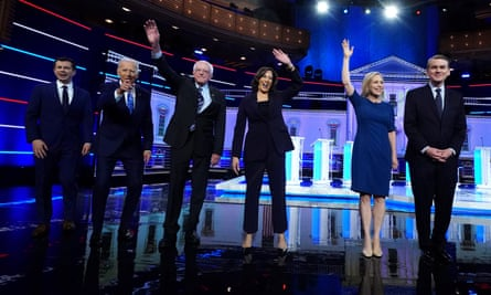 Candidates pose before the start of the second night of the first US 2020 presidential election Democratic candidates debates in Miami, Florida