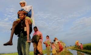 Rohingya refugees walk to take shelter in the southern part of Bangladesh at Palongkhali in Coxs Bazar.