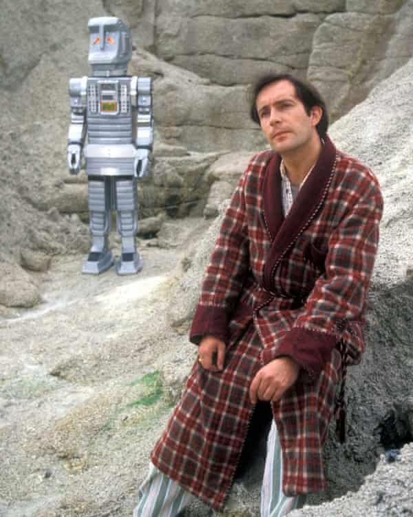 Simon Jones as Arthur Dent, with Marvin the Paranoid Android in the TV series.