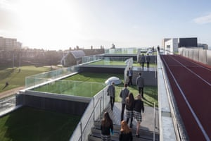 The terraced roof of Brighton college's new sports hall, complete with running track and sea views.
