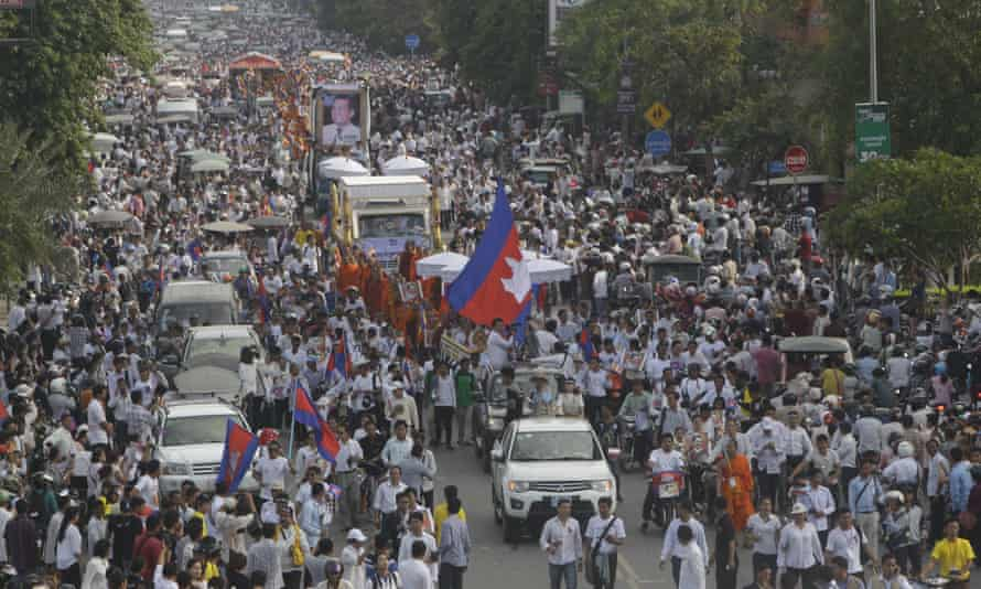 Cambodia mourners march during a funeral procession for  Kem Ley in Phnom Penh on Sunday