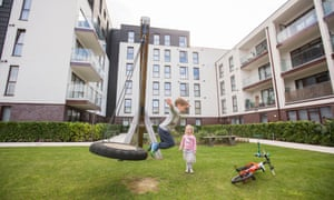 Children enjoy the main play area at the Old Baylis School. Children living in its social housing units are blocked from using the space.