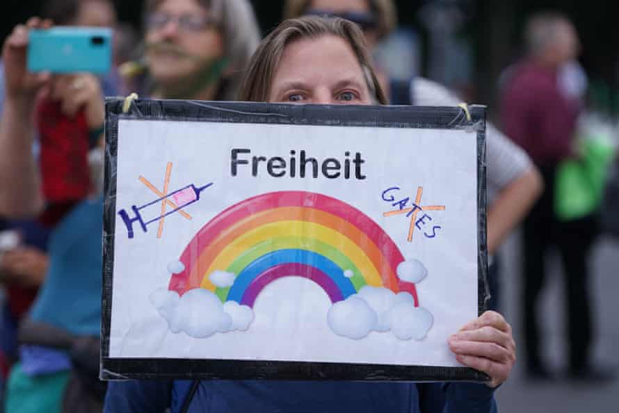 A woman holds a sign that reads 'Freedom' and refers to vaccines and Bill Gates at a gathering of coronavirus skeptics in Berlin in August.