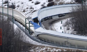 A tarp covers the intersection of the bobsled and luge tracks at the Canada Olympic Park in Calgary, after two young men died in a toboggan accident.