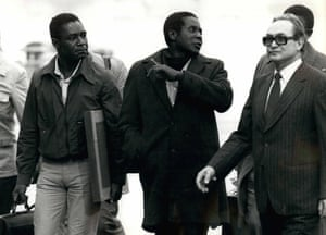 Leader of the Zimbabwe African National Union (ZANU), Robert G. Mugabe arrives at Geneva Airport with his delegation to take part in the Rhodesia Conference