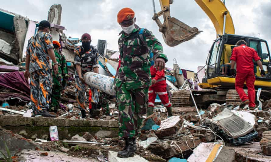 Rescuers work on damaged buildings after a 6.2-magnitude earthquake hit Mitra Manakarra hospital in Mamuju, West Sulawesi, Indonesia.