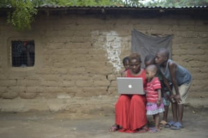 Filmmaker Aminah Rwimo shows children in Kakuma refugee camp how video editing is done