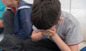 A young child refugee at Calais.