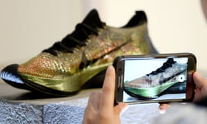 An attendee takes a picture at the launch of the Nike Zoom Vaporfly Elite Flyprint in April.
