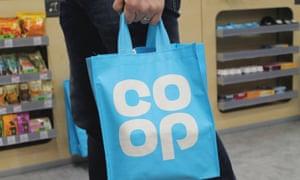 shopper carrying Co-op bags