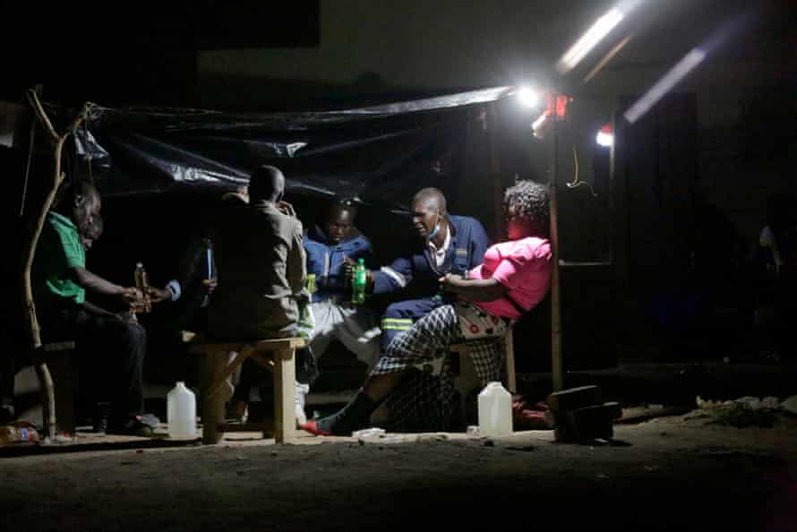 Drinkers at a shebeen in Mabvuku.