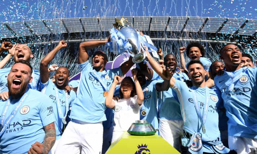 Manchester City players lifted the Premier League trophy after the 0-0 draw with Huddersfield.