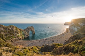 By Sidra Nawaz. A late-summer afternoon overlooking Durdle Door on the Jurassic Coast in Dorset. I love the warm light of the sun illuminating the limestone arch and casting long shadows before the visitors as they leave the beach.