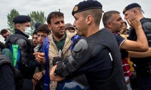 Croatian riot police officers control the access to a refugee camp as more migrants arrive from the Serbian border. Croatia has built a refugee camp to control the transit of migrants to Hungary with a capacity of 4,000 people.