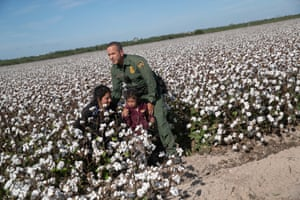 Border Patrol agent Carlos Ruiz apprehends a mother and daughter from Ecuador on 10 September 2019 in Penitas, Texas.