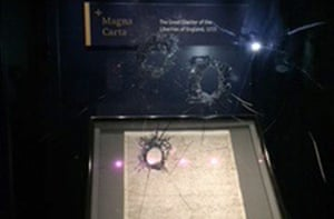Holes in the reinforced glass in the case protecting Magna Carta