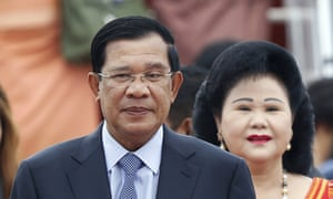 The family of Hun Sen, shown with wife Bun Rany, is accused of bleeding the country of wealth under his prime ministership.