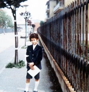 Gianluca Vialli poses for a photo as a young boy