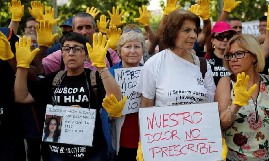 Protesters gather outside the Madrid court where Eduardo Vela is accused.