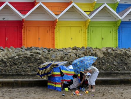 woman and child in bad weather on a uk beach