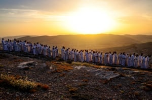 Samaritan worshippers arrive to take part in a Passover ceremony on top of Mount Gerizim in the West Bank
