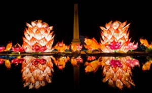 Sculptures are reflected in the lotus pool