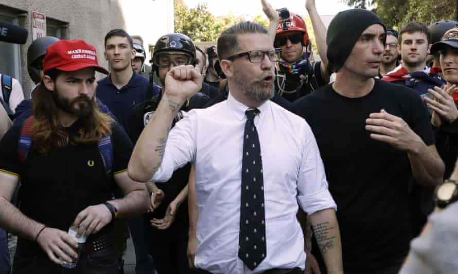 Vice Media co-founder Gavin McInnes, center, founder of the far-right group Proud Boys, is surrounded by supporters after speaking at a rally in Berkeley, California on 27 April 2017.