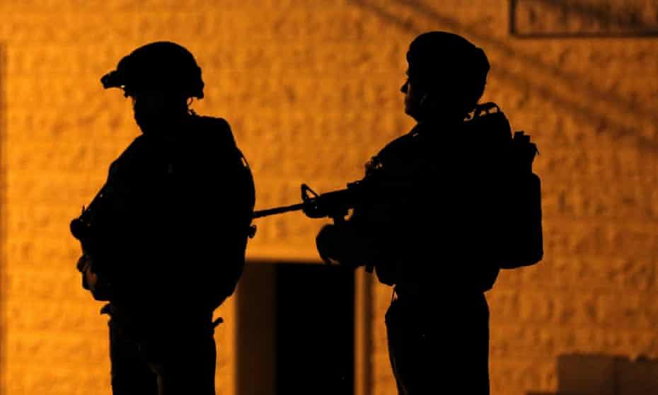 Israeli troops seen during a night raid on the West Bank last week