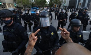 A man a conveys his message to police during a protest sparked by the death of George Floyd while in police custody on May 29, 2020 in Oakland, California.