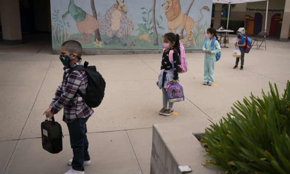 Socially distanced kindergarten students wait for their parents to pick them up on the first day of in-person learning at Maurice Sendak elementary school in Los Angeles in April.