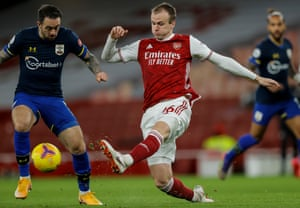 Rob Holding of Arsenal and Danny Ings of Southampton.