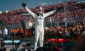 Lewis Hamilton celebrates his win for Mercedes at the Hungaroring.