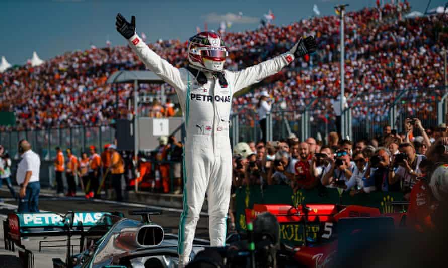 Lewis Hamilton celebrates his win for Mercedes at the Hungaroring.