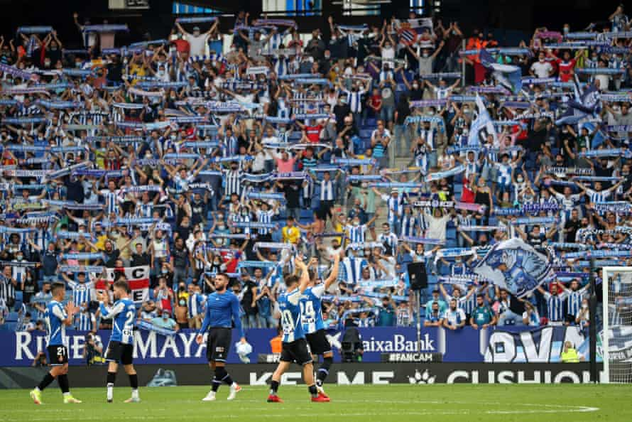 Espanyol players celebrate a famous win in front of their fans.