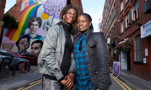 Megan Nankabirwa ( blue hair tips) and her partner Lydia Nabukenya in Manchester's gay village.