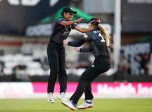 Manchester Originals' Harmanpreet Kaur (left) celebrates with Sophie Ecclestone after taking a catch to dismiss Oval Invincibles' Fran Wilson.