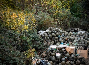 A pile of Armenian army helmets lie on the ground close to the barracks near Stepanakert.