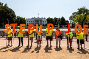 People take part in a voting rights rally in front of the White House in Washington, nine holding individual letters that spell out STEP UP JOE