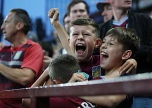 Aston Villa fans celebrate as Wesley scores the opener against Everton at Villa Park.